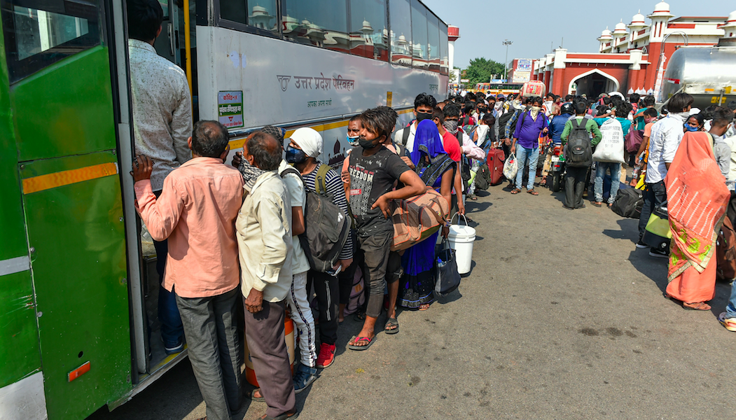 Migrants board special buses to return to their hometowns after they arrived at Charbagh Railway Station from various parts of the country, during ongoing COVID-19 lockdown in Lucknow. Photo PTI