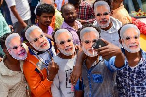 Bengaluru: BJP workers wear masks of Prime Minister Narendra Modi as they arrive in support of Bengaluru Central candidate PC Mohan, as he filed his nomination papers ahead of Lok Sabha Election 2019, in Bengaluru, Friday, March 22, 2019. (PTI Photo/Shailendra Bhojak) (PTI3_22_2019_000078B)