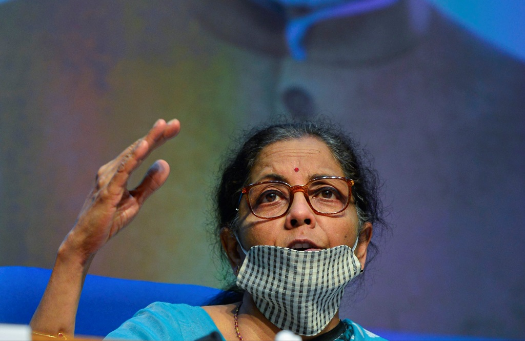 New Delhi: Union Finance Minister Nirmala Sitharaman wearing a face mask gestures as she announces the government's economic package to fight the coronavirus pandemic, during a news conference, in New Delhi, Wednesday, May 13, 2020. (PTI Photo/Kamal Kishore) (PTI13-05-2020_000153B)