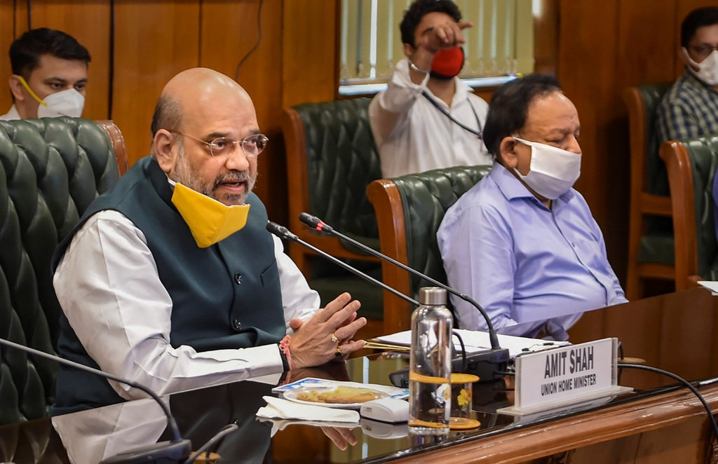 New Delhi: Union Home Minister Amit Shah with Health Minister Harsh Vardhan (R) holds a meeting to discuss the COVID-19 situation in Delhi, at North Block in New Delhi, Sunday, June 14, 2020. The meeting comes in the wake of increasing number of coronavirus cases in Delhi, where the tally has reached nearly 39,000 cases and the death toll rose to over 1,200. (PTI Photo/ Shahbaz Khan)