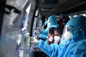Vijayawada: Healthcare workers prepare themselves to collect the swab samples of passengers returning to Vijayawada by Konark Express train, inside a mobile swab collection bus at Vijayawada Railway Station, during the ongoing COVID-19 lockdown, in Vijayawada, Tuesday, June 2, 2020. (PTI Photo)(PTI02-06-2020 000165B)