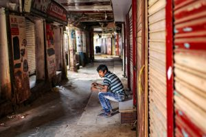 New Delhi: A man sits in front of a closed shop at deserted Lajpat Rai market in Chandni Chowk, during ongoing COVID-19 lockdown in New Delhi, Sunday, May 31, 2020. (PTI Photo/Ravi Choudhary) (PTI31-05-2020 000041B)