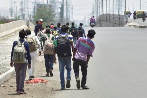 Ghaziabad: Migrants walk along a road on NH-24 to reach their native places, during the nationwide COVID-19 lockdown, in Ghaziabad, Saturday, May 30, 2020. (PTI Photo/Vijay Verma)(PTI30-05-2020 000024B)