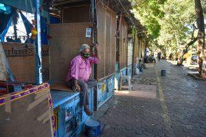 Mumbai: A man wearing a protective mask in the wake of coronavirus pandemic, sits at one of the closed shops at Fashion Street, in Mumbai, Thursday, March 19, 2020. (PTI Photo/Mitesh Bhuvad)(PTI19-03-2020_000157B)
