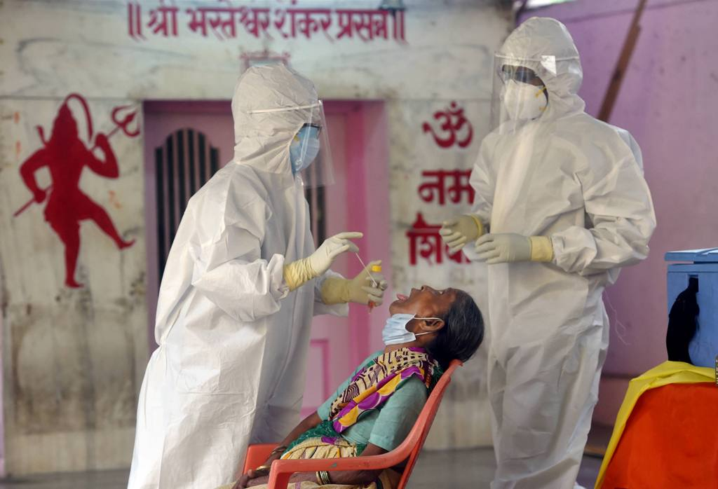 Mumbai: Medics collect swab sample of a woman for COVID-19 test, as part of a drive to control the spread of the novel coronavirus, during the unlock-2, in Parel, Mumbai, Thursday, July 2, 2020. (PTI Photo/Shashank Parade)(PTI02-07-2020 000138B)