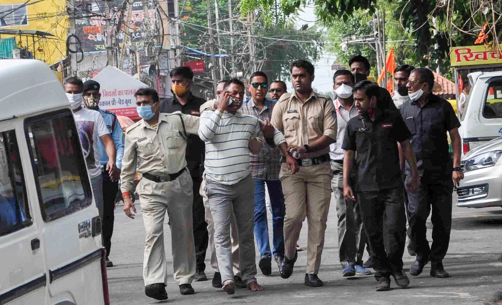 Ujjain: Gangster Vikas Dubey, the main accused in killing of eight policemen in the Kanpur encounter recently, being apprehended by police personnel after a nearly week-long manhunt, in Ujjain, Thursday, July 9, 2020. (PTI Photo)(PTI09-07-2020 000172B)