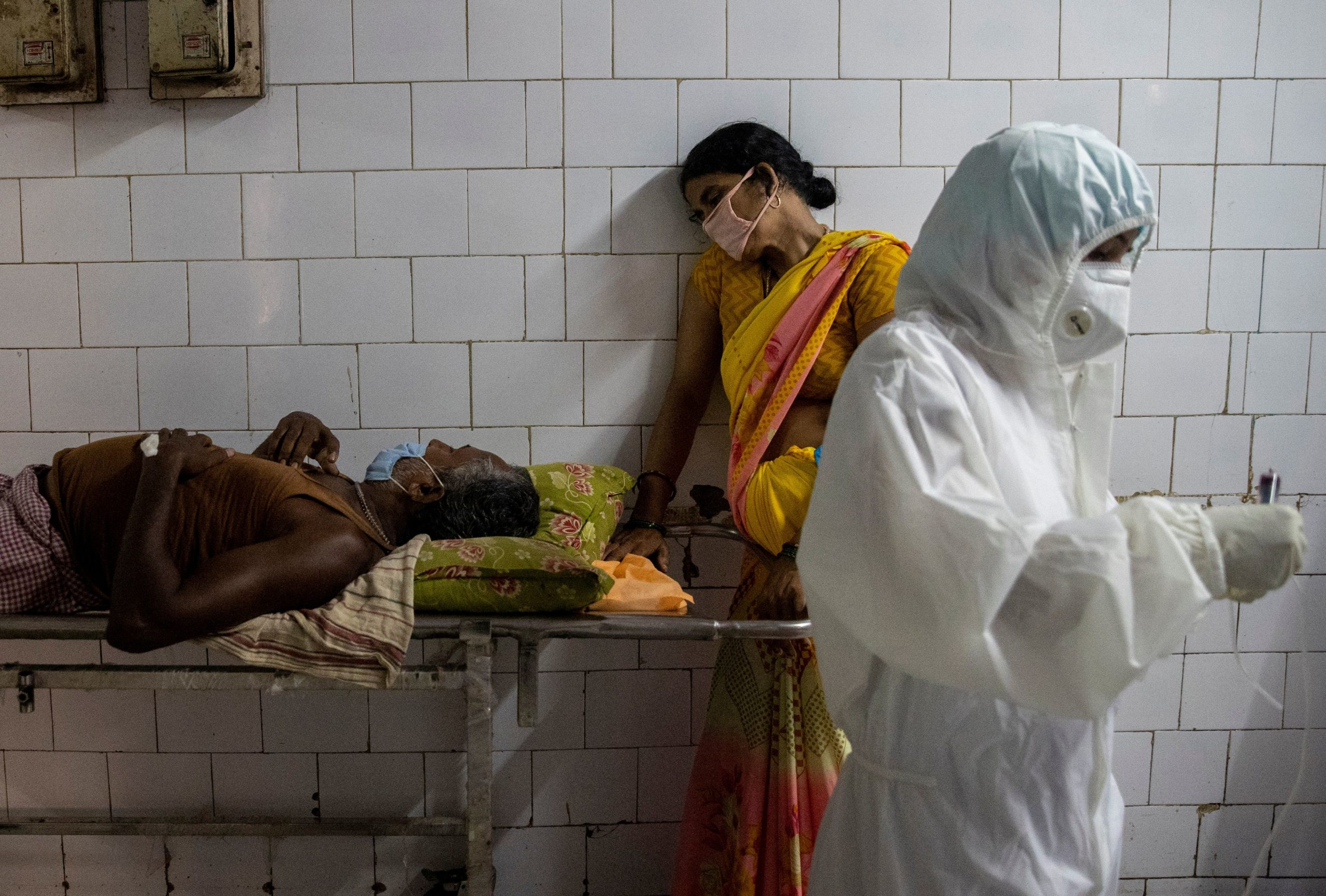 A woman leans against a stretcher holding her husband in the corridor of the emergency ward of Jawahar Lal Nehru Medical College and Hospital, during the coronavirus disease (COVID-19) outbreak, in Bhagalpur, in the eastern state of Bihar, India, July 27, 2020. REUTERS/Danish Siddiqui