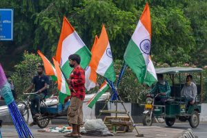 New Delhi: A roadside vendor sells the Tricolors at a traffic signal ahead of the Independence Day, during Unlock 3.0, in New Delhi, Saturday, Aug 8, 2020. (PTI Photo/Kamal Singh)(PTI08-08-2020 000113B)