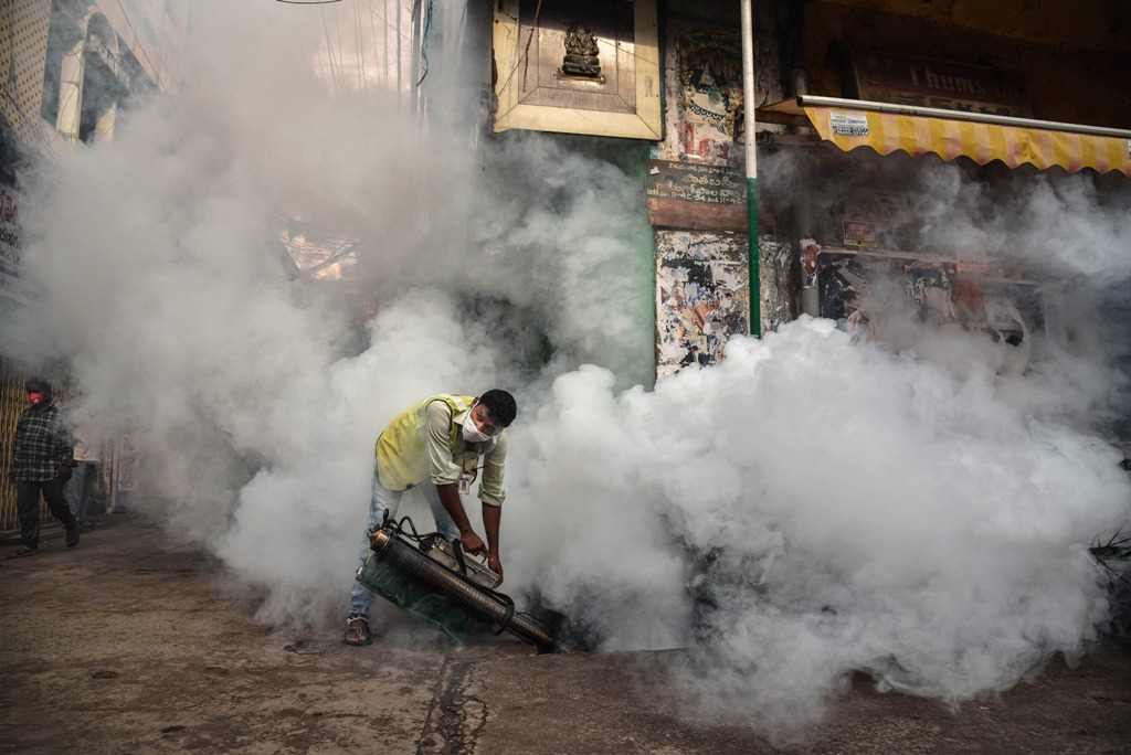 Vijayawada: A corporation worker carries out fumigation work as part of preventive measures against the mosquito-borne diseases, during the monsoon season in Vijayawada, Sunday, July 12, 2020. (PTI Photo) (PTI12-07-2020 000032B)
