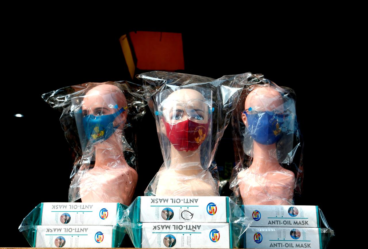 Mannequins wearing protective face masks and face shields are displayed at a market amid the coronavirus disease (COVID-19) outbreak in Jakarta, Indonesia, July 30, 2020. REUTERS/Ajeng Dinar Ulfiana