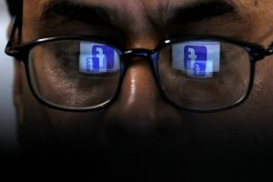 Facebook logo is reflected in glasses in this picture illustration taken on Apr 1, 2019. (Photo: REUTERS/Akhtar Soomro)