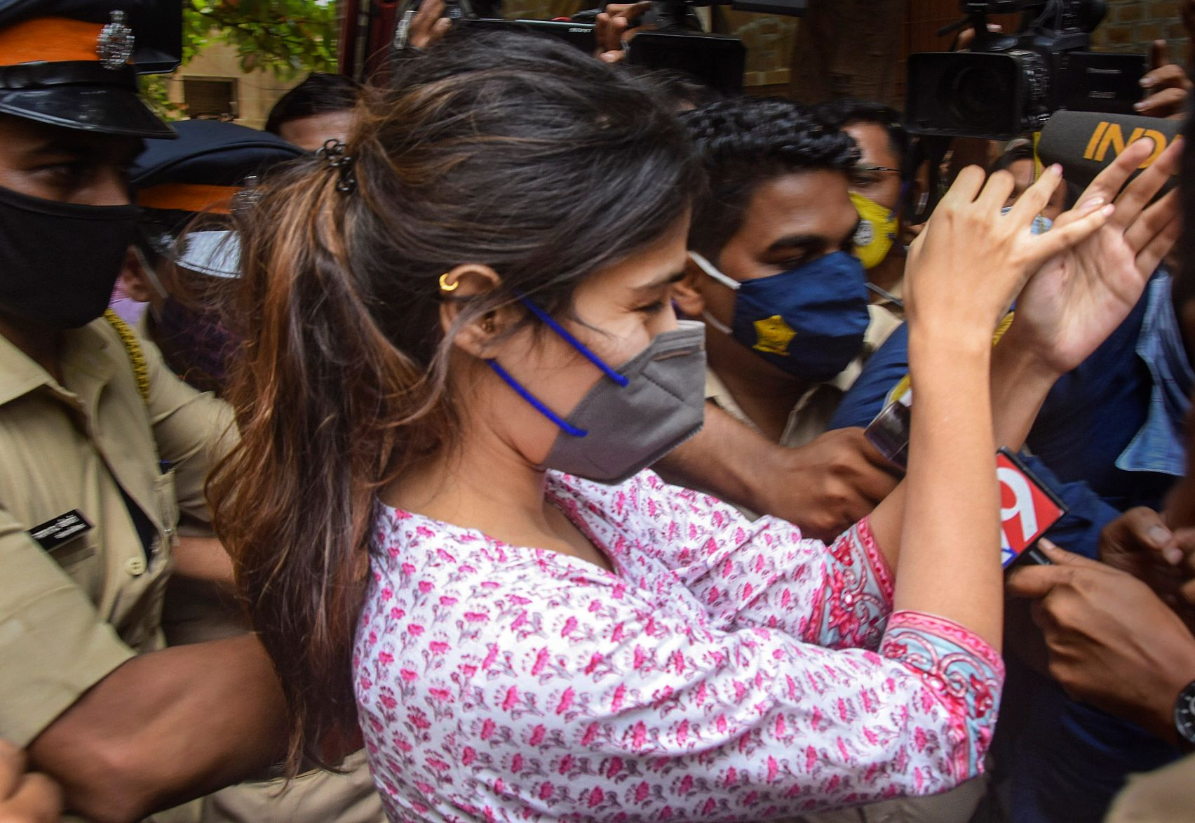 Mumbai: Rhea Chakraborty outside NCB office after being summoned for questioning in connection with the death by suicide case of Sushant Singh Rajput, at Ballard Estate in Mumbai, Sunday, Sept. 6, 2020. (PTI Photo)(PTI06-09-2020 000059B)
