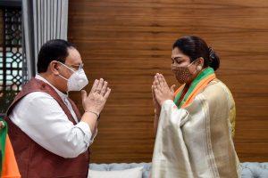 New Delhi: BJP National President JP Nadda greets Tamil film actress and former Congress spokesperson Khushbu Sundar, who joined BJP, at party HQ in New Delhi, Monday, Oct. 12, 2020. (PTI Photo/Kamal Singh)(PTI12-10-2020 000076B)