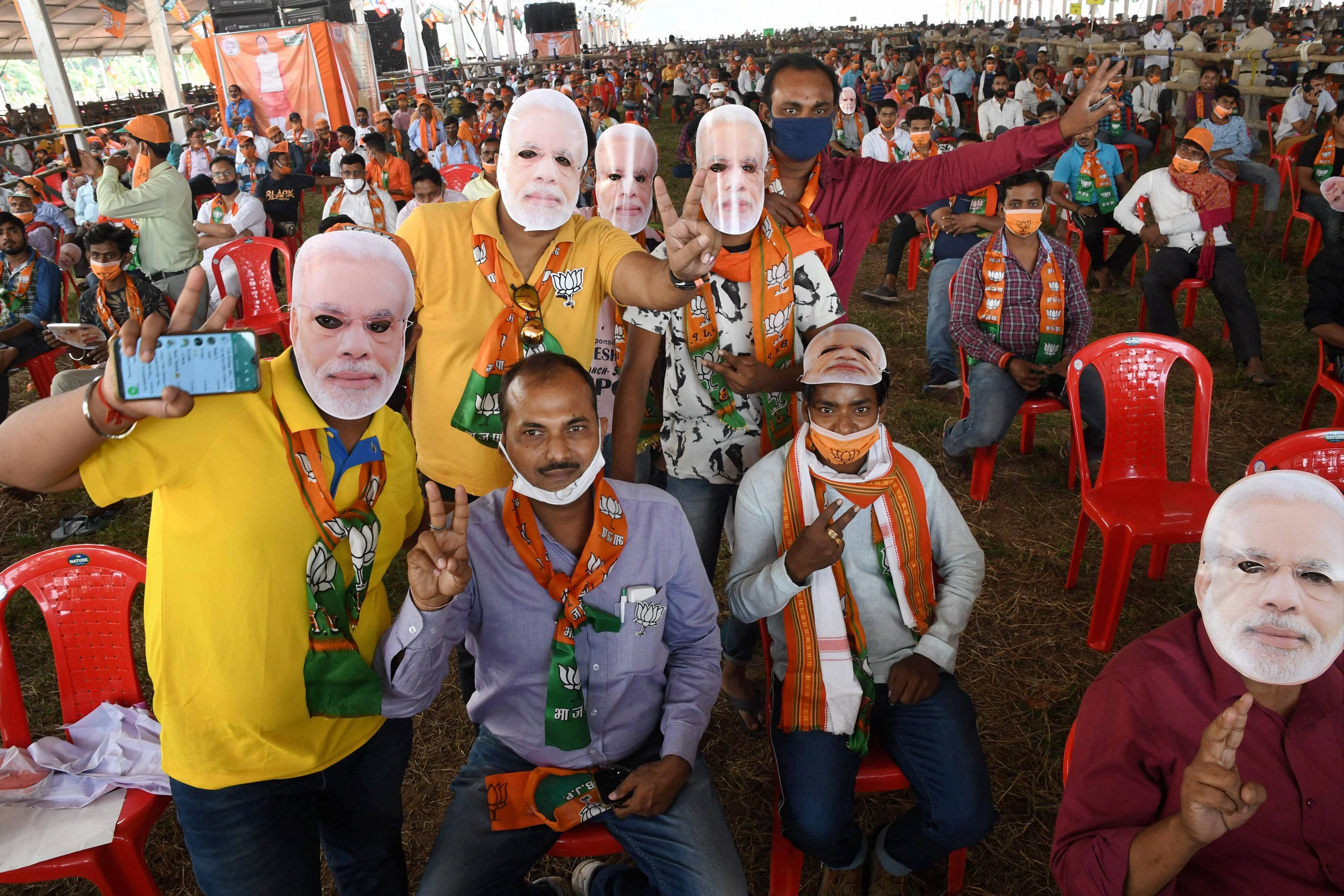 Patna:BJP supporters during Prime Minister Narendra Modi's election rally during the second leg of his campaign for Bihar assembly elections, in Patna, Wednesday, Oct. 28, 2020. (PTI Photo)(PTI28-10-2020_000169B)