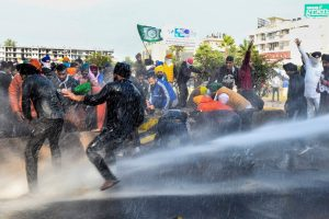 Ambala: Police personnel use water canons on farmers to stop them from crossing the Punjab-Haryana border during Delhi Chalo protest march against the new farm laws, near Ambala, Thursday, Nov. 26, 2020. (PTI Photo)(PTI26-11-2020 000140B)