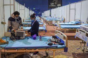 New Delhi: Security staff members work inside CWG village COVID-19 Care Centre near Akshardham, in New Delhi, Friday, Dec. 25, 2020. (PTI Photo/ Manvender Vashist)(PTI25-12-2020 000206B)