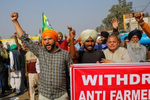 New Delhi: Farmers shout slogans at Singhu border during a protest against the new farm laws, in New Delhi, Friday, Dec. 25, 2020. (PTI Photo/Ravi Choudhary)(PTI25-12-2020 000113B)
