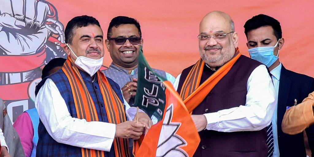 West Midnapore: Union Home Minister Amit Shah (R) with Subhendu Adhikary (2L), former TMC leader who joined BJP, during an election rally ahead of West Bengal Assembly polls 2021, in West Midnapore district, Saturday, Dec. 19, 2020. (PTI Photo)(PTI19-12-2020 000181B)