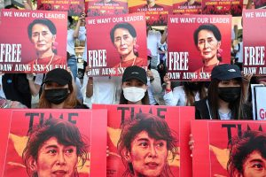 Demonstrators hold up signs during a protest against the military coup and demanding the release of elected leader Aung San Suu Kyi, in Yangon, Myanmar, February 13, 2021. REUTERS/Stringer