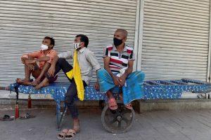 New Delhi: Labourers take rest in a closed market at Khari Baowli, during COVID-19 lockdown in New Delhi, Tuesday, May 25, 2021. (PTI Photo/Vijay Verma)(PTI05 25 2021 000122B)